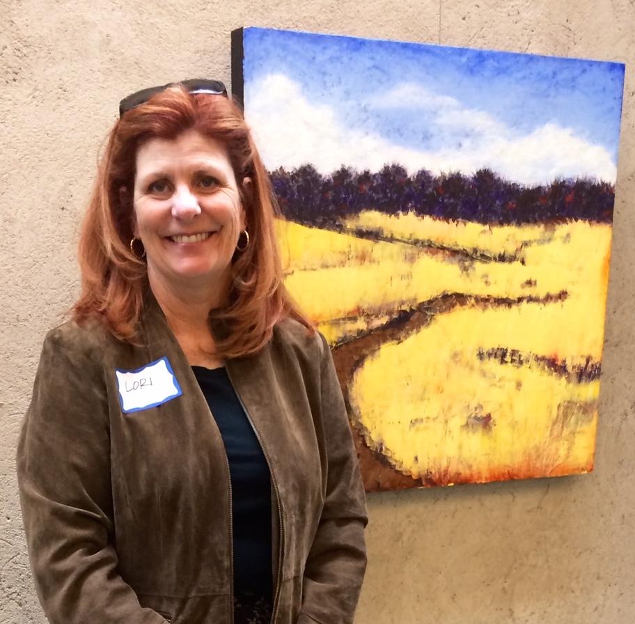 "At the Encaustic Art Institute in Santa Fe with my painting ""Prairie Road."""