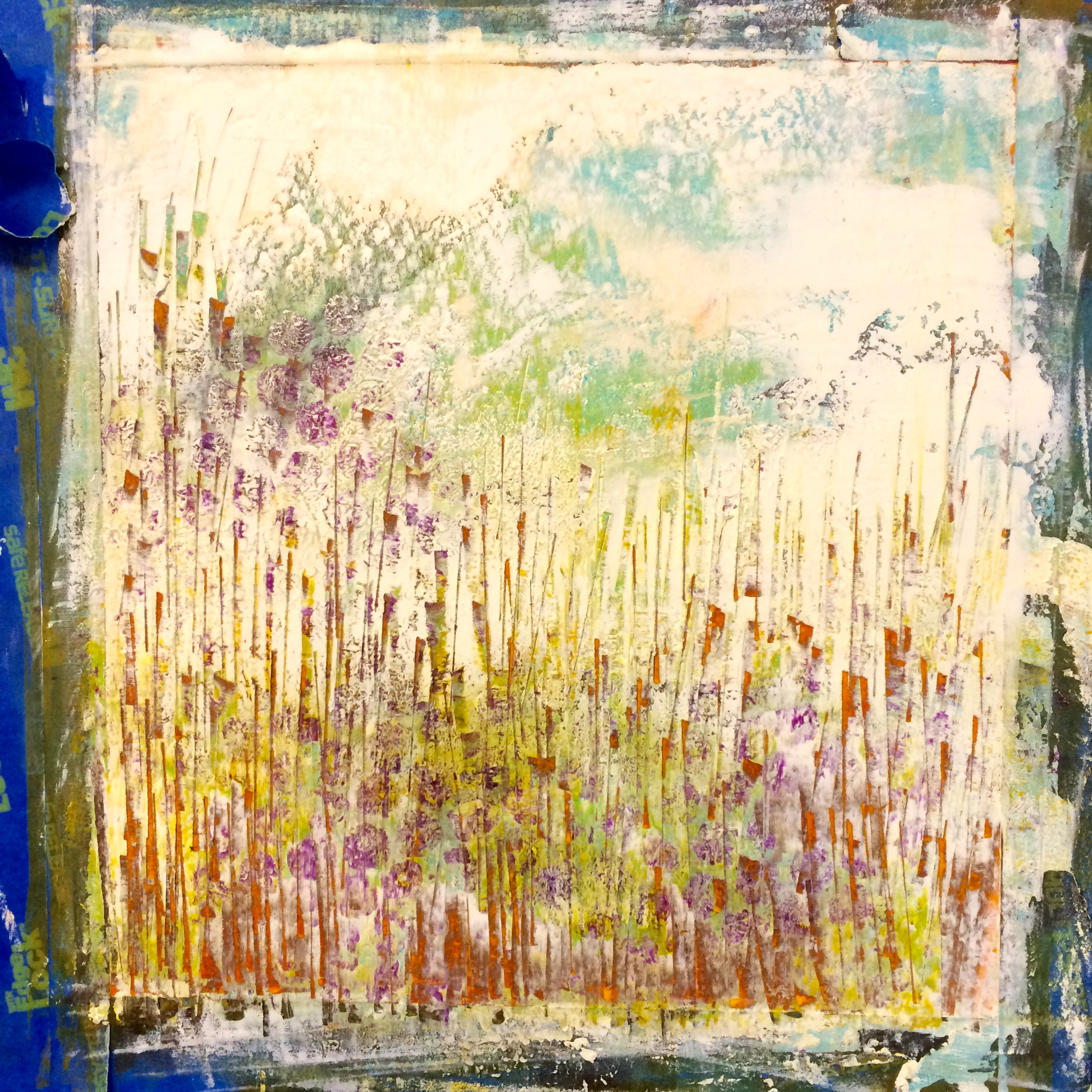 a small painting on paper has about 10 layers of pigment and wax; scraping and scratching reveals underlying colors.