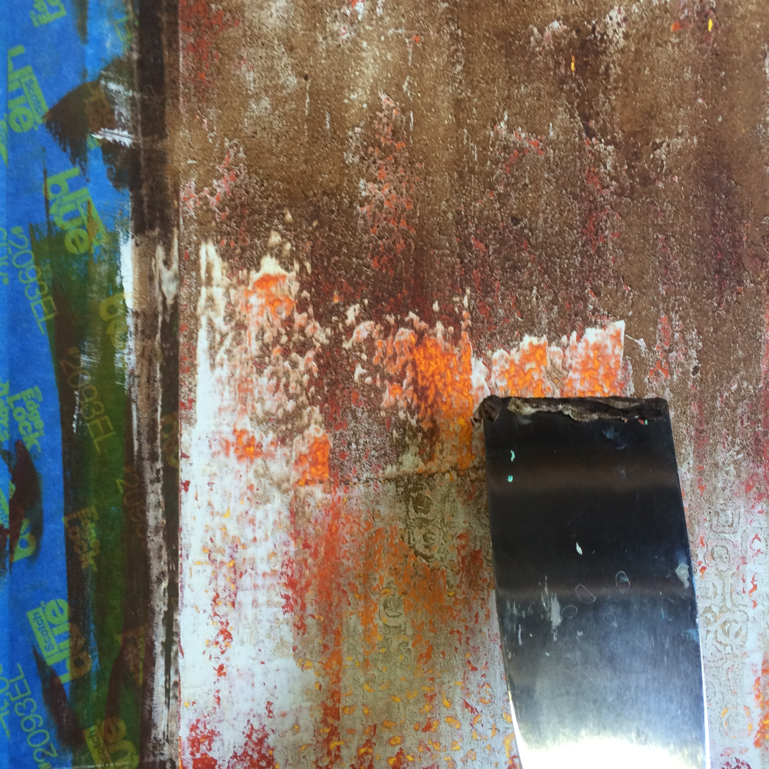 scraping with a utility knife to reveal underlying colors