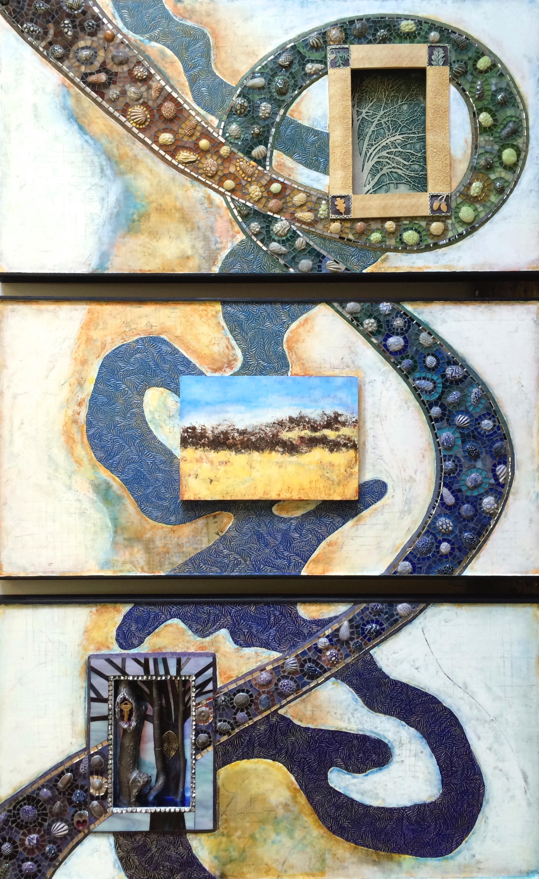 """Rivers, Roads, Remains"" is a 3-panel (each 20"" x 40"")  mixed-media artwork, portraying ideas connected to the Missouri River. It includes old maps, found objects and the mosaic path echoes the line of the Bob Kerrey bridge that links Omaha and Council Bluffs."
