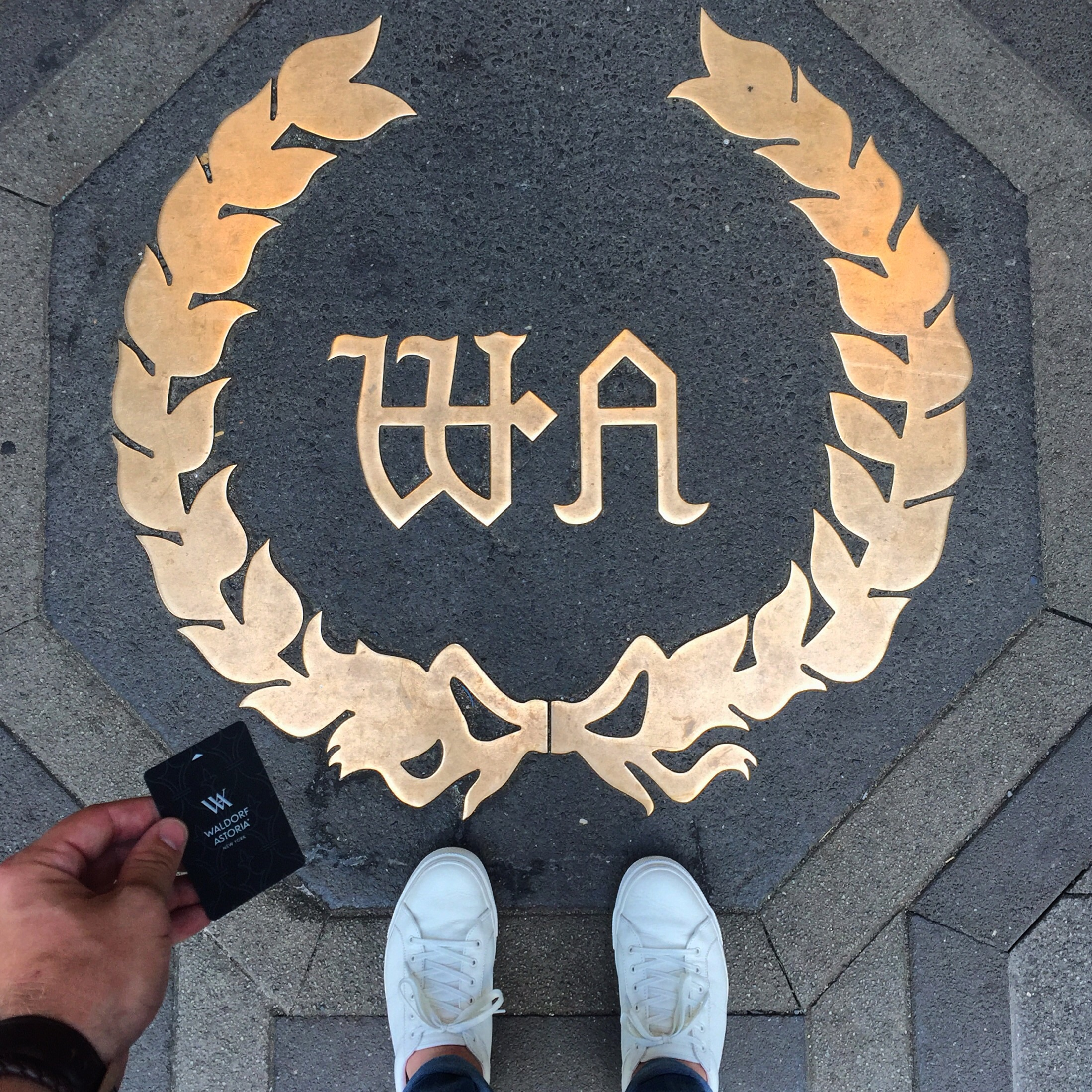 The Park Avenue entrance of the Waldorf Astoria with my black card.