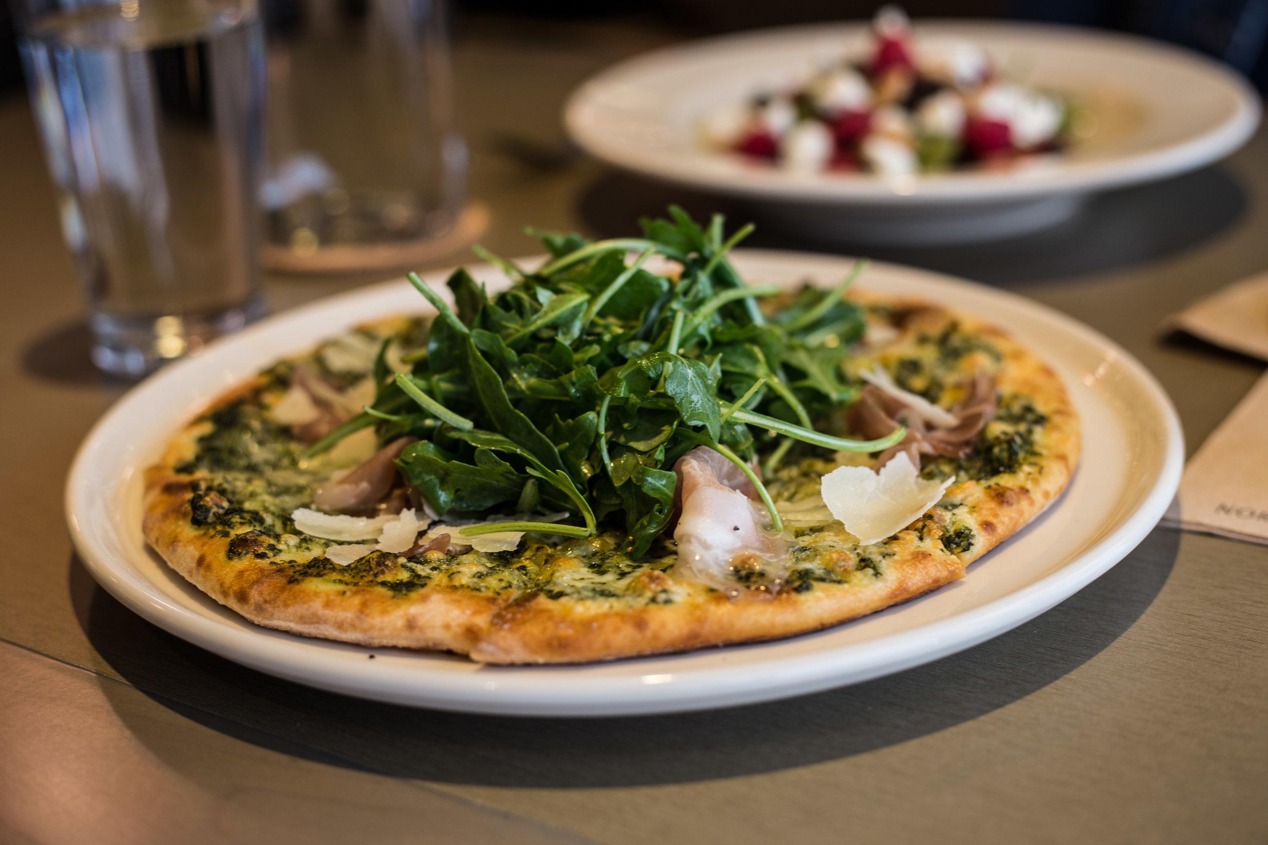 Prosciutto and Arugula Pizza at Bazille