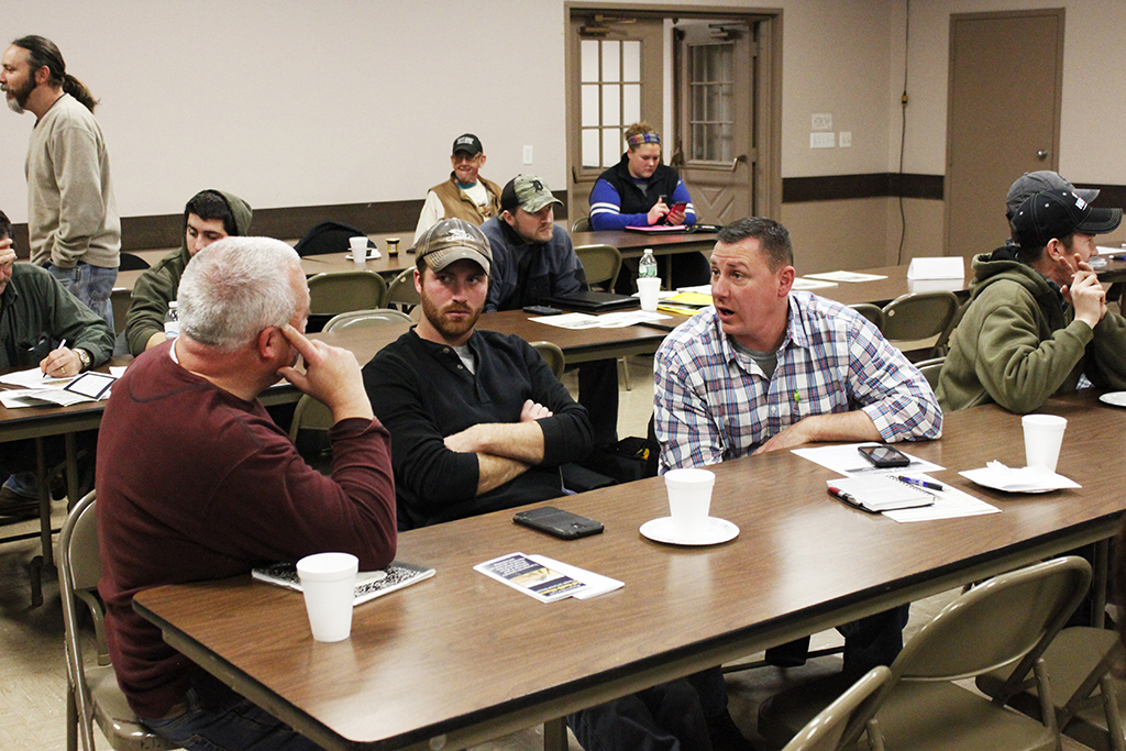 Jeff Toussaint (left) and his son, Matt (center) at the WNY Soil Health Alliance's 2015 Annual Meeting and Soil Health Workshop. Photo by Jena Buckwell.