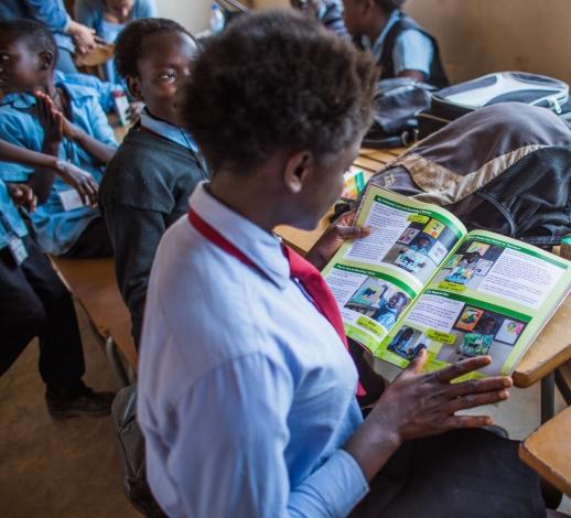 day1-zambia-ksw-girlreadingbook.jpg