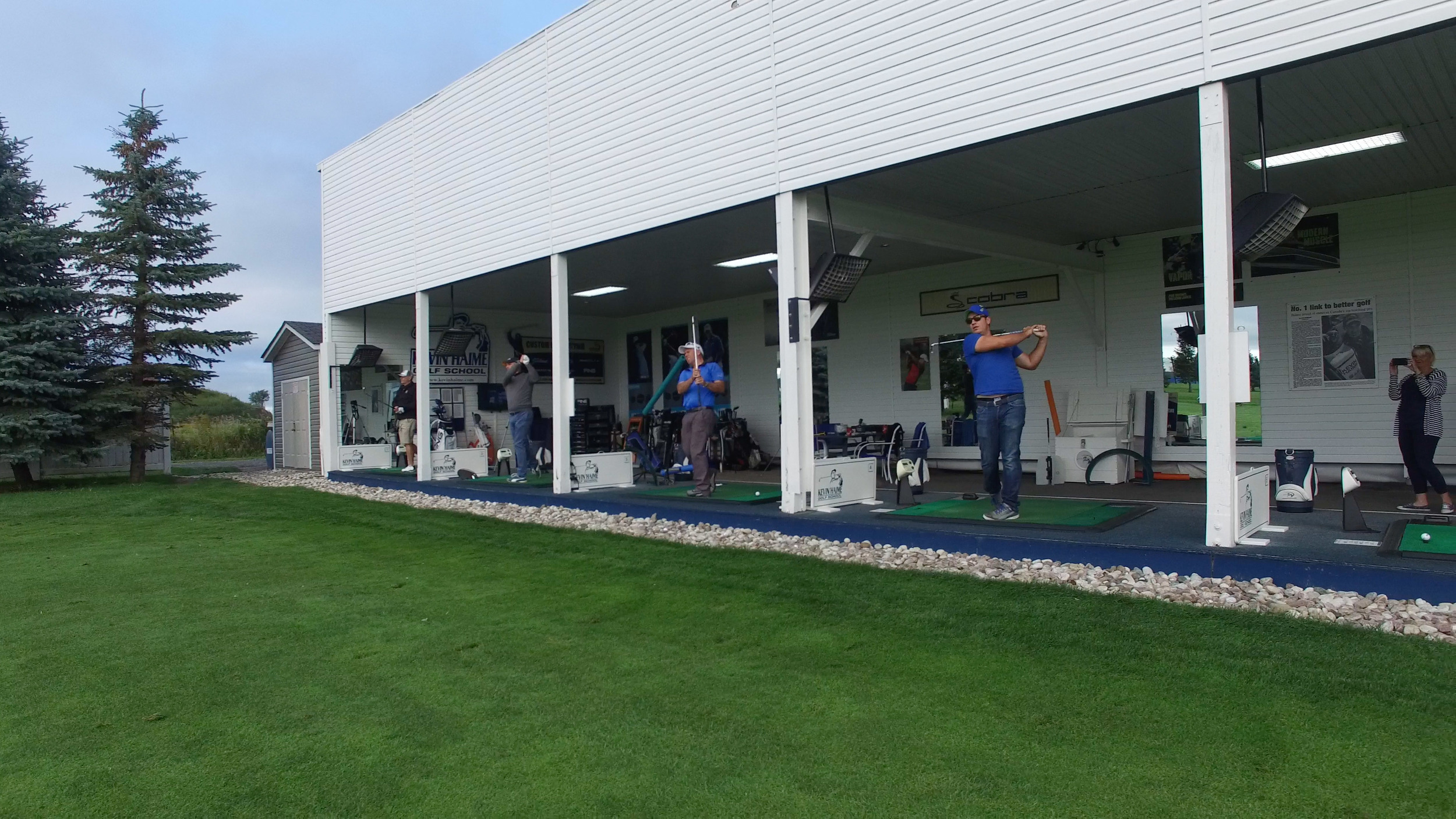 Covered and heated practice stations with Power Tee automated ball dispenser