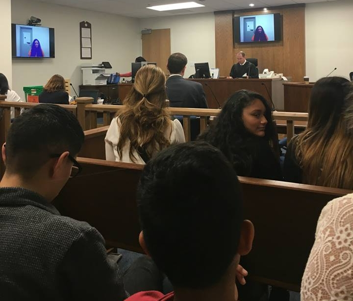 Claudia's family and friends inside the courtroom at her bond hearing. Claudia was present via video chat and can be seen on the screens.