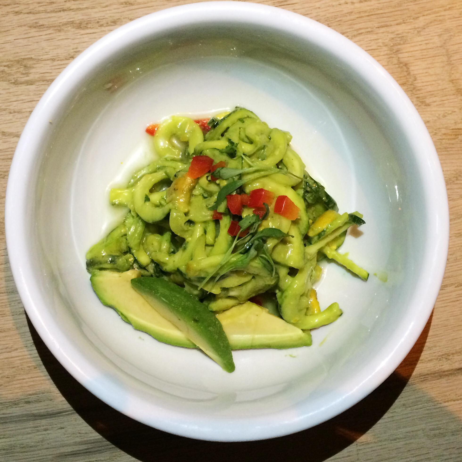 Sixth And A Half  Course Green Curry   zucchini noodles, avocado, thai chili, scallion, red bell pepper, curried cashews, thai basil, cilantro, lime.