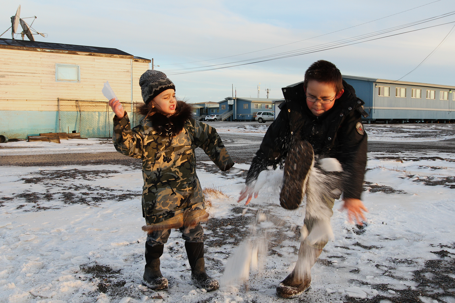 A storm covers the town in thick sheets of ice, and makes a good reason to play outside once it clears.