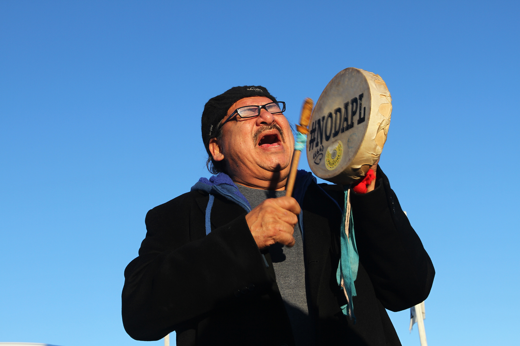 A man sings in celebration after the announcement that the Army Corps denied DAPL drilling permits.