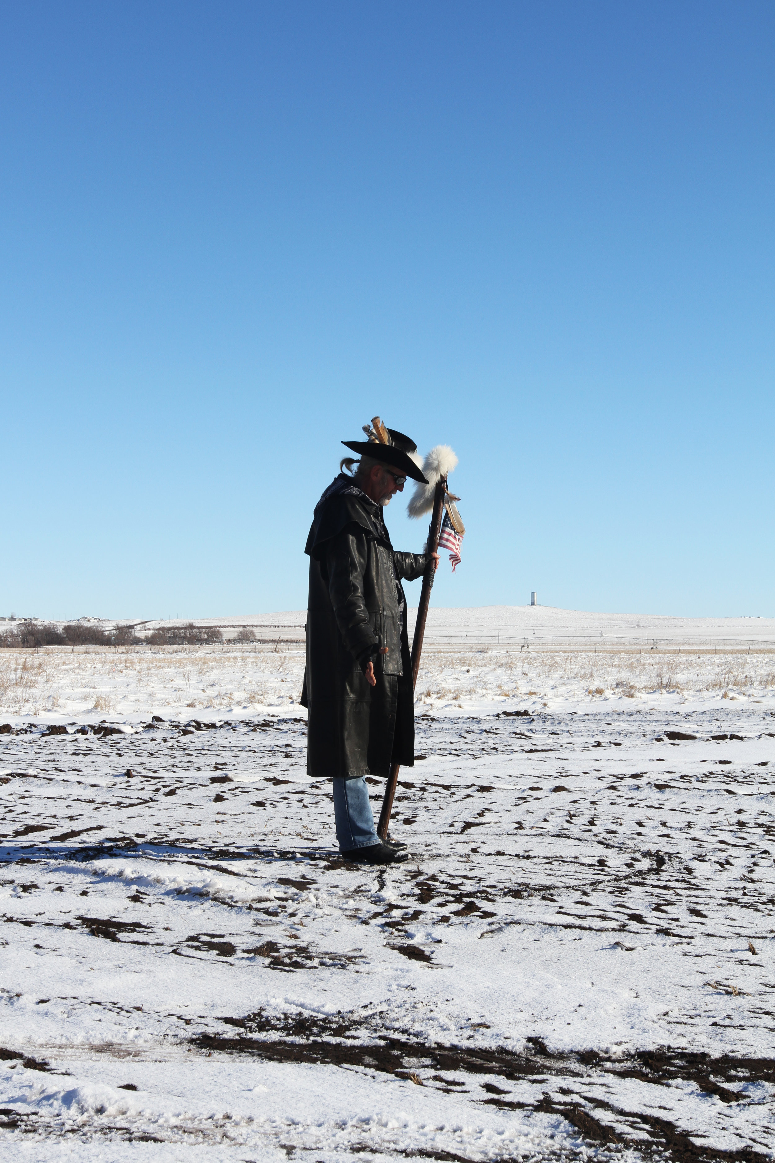 White Fox felt called to lend support to the people of Standing Rock through prayer. His son served two tours in Iraq as a marine. Here he conducts a prayer ritual while veterans, who have also come to support the protest, receive their briefing.