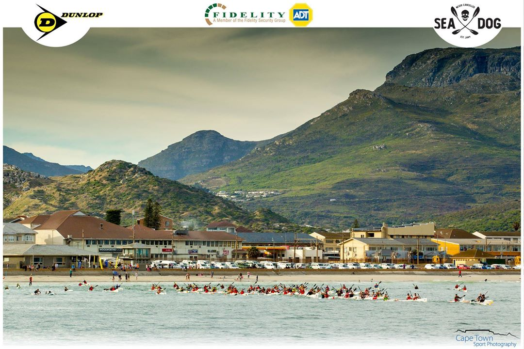 Paddlers make their way out of the beautiful Fish Hoek bay for the Dunlop Race 7. (Photo: Cape Town Sport Photography)
