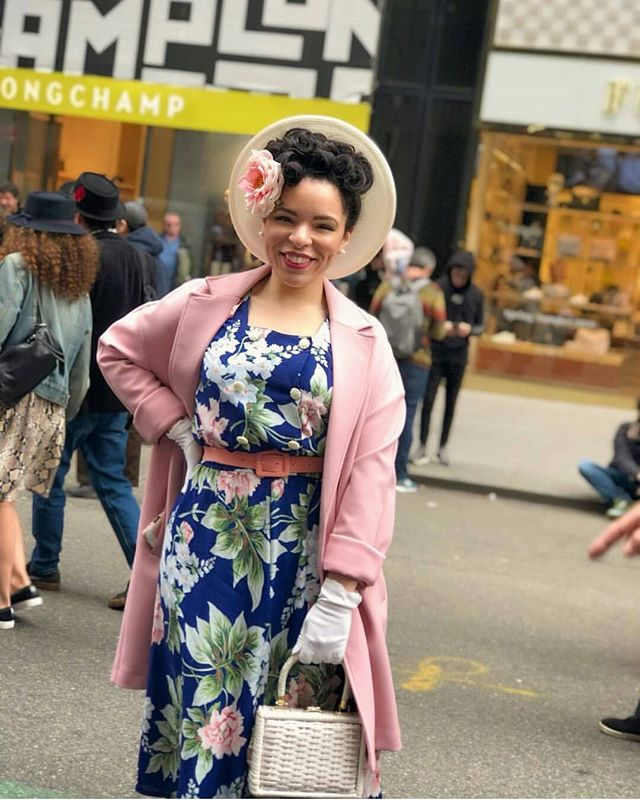 Reposting this amazing photo by @lindsayonfilm of my Easter #ootd . I'm so glad I met her and her husband yesterday (they're both so fabulous!) Oh yeah, I changed my hair! 💁 I've been seeing miracle worker Maribel @velvetrosesbeautysalon for years and there's no one I trust more.  #easterparadenyc #easterparade 👒 @uniquevintage 👜, gloves - vintage 👗- @averydayvintage  coat- @primark 💄- @thebeautycrop  pbj smoothie stick 🌹- #diy hair flower clip I made with a bloom from @michaelsstores