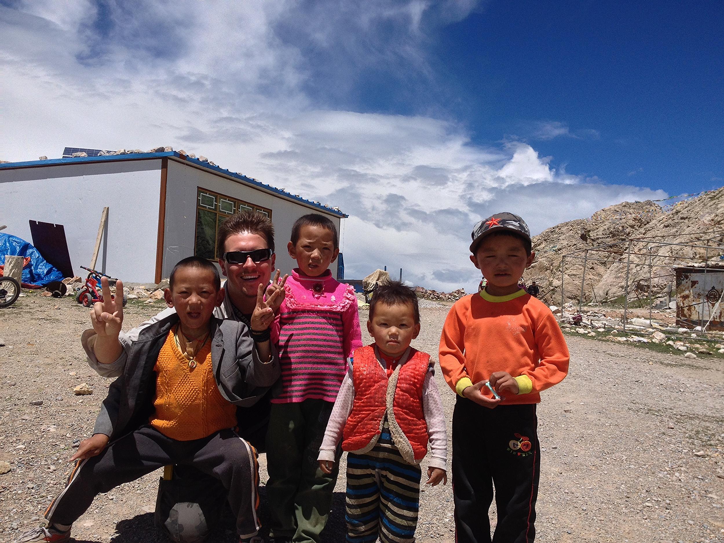 Dr. Matthew M. Wielicki with Tibetan children at Nam Co, Tibet, China.