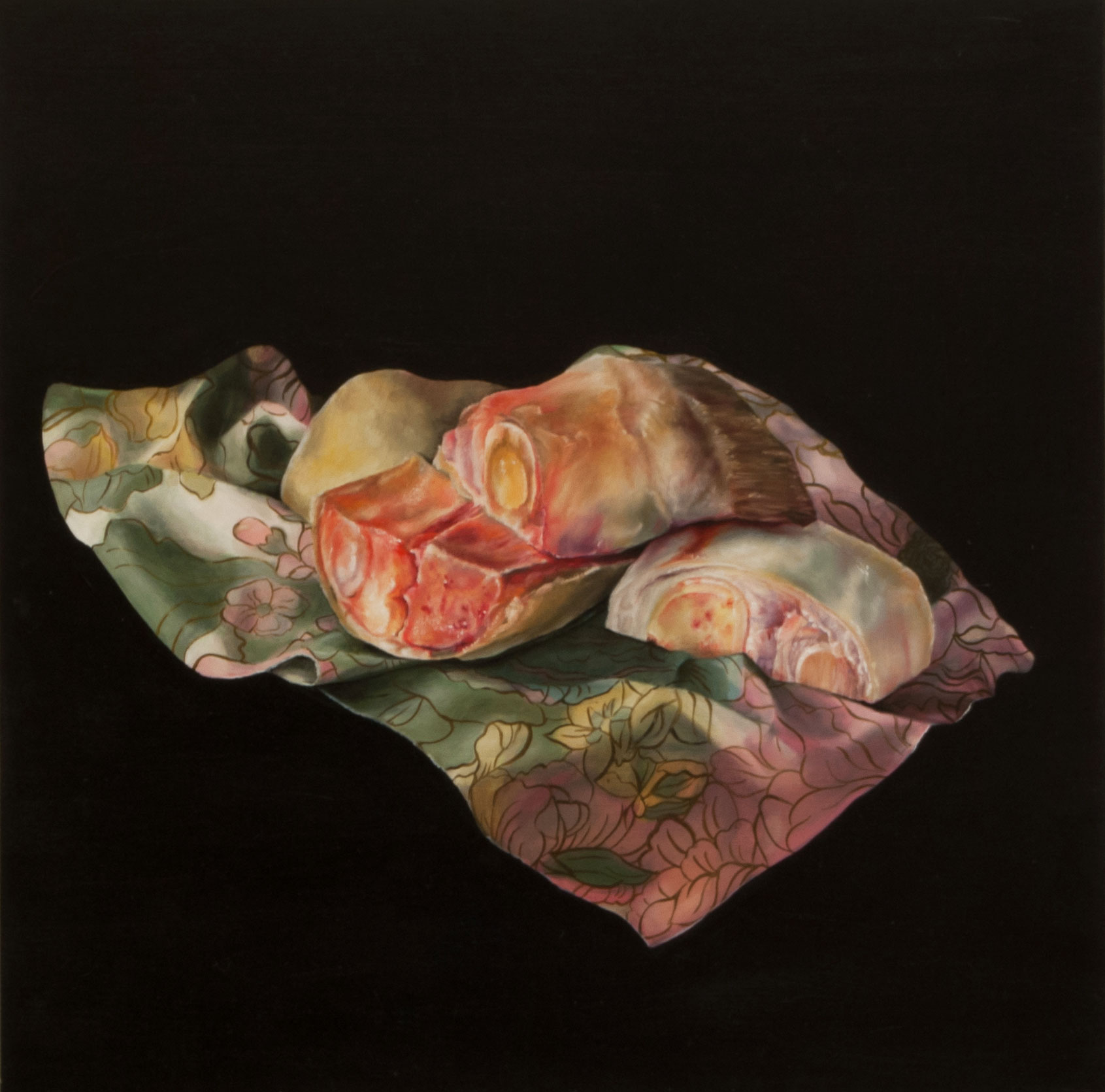 raw meat on floral fabric