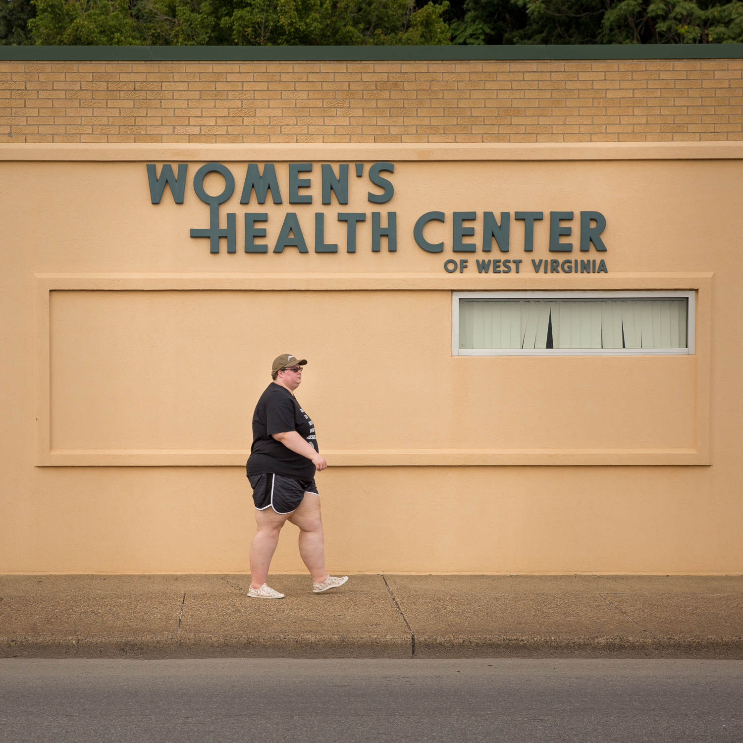 Here, Rachel stands outside the only abortion clinic in the state of West Virginia. This is where she had her second abortion performed.