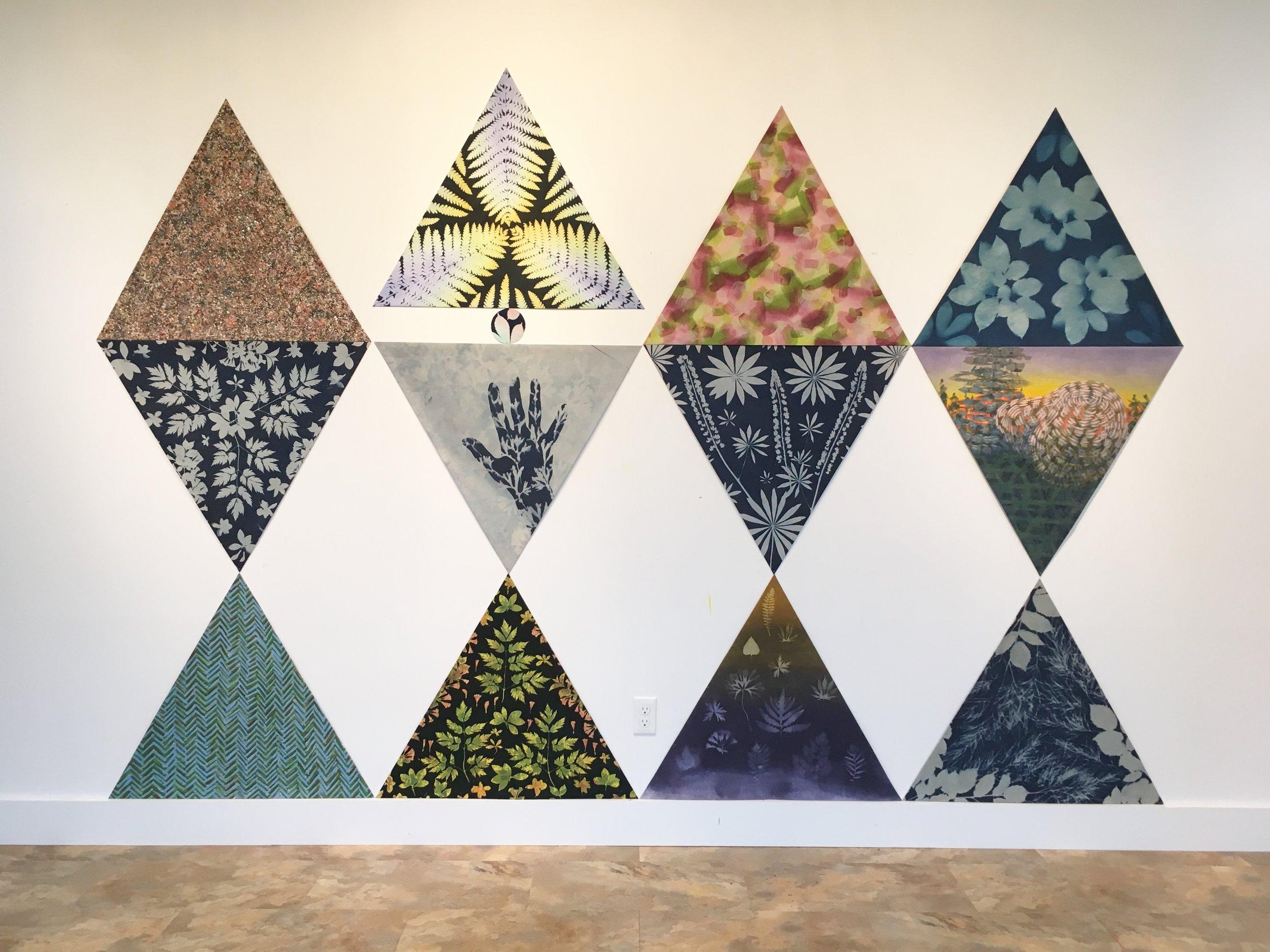 "Qonasqamkuk , 2018. (12) 32"" rearrangeable canvas panels."