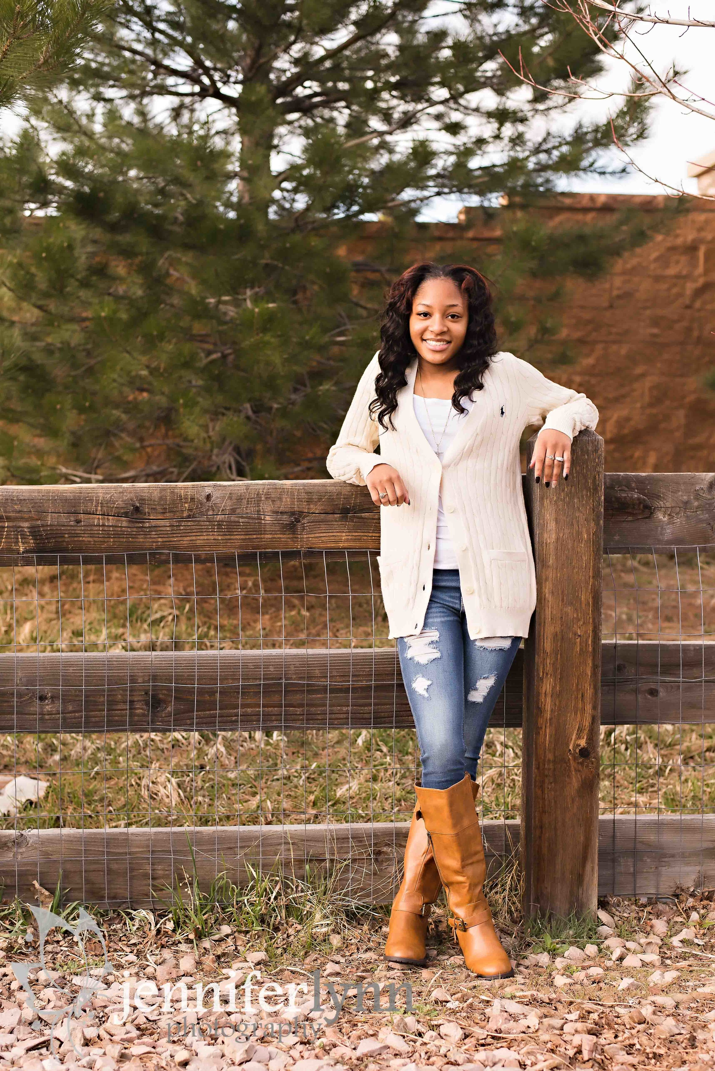 Senior Girl-Leaning on Rustic Wooden Fence