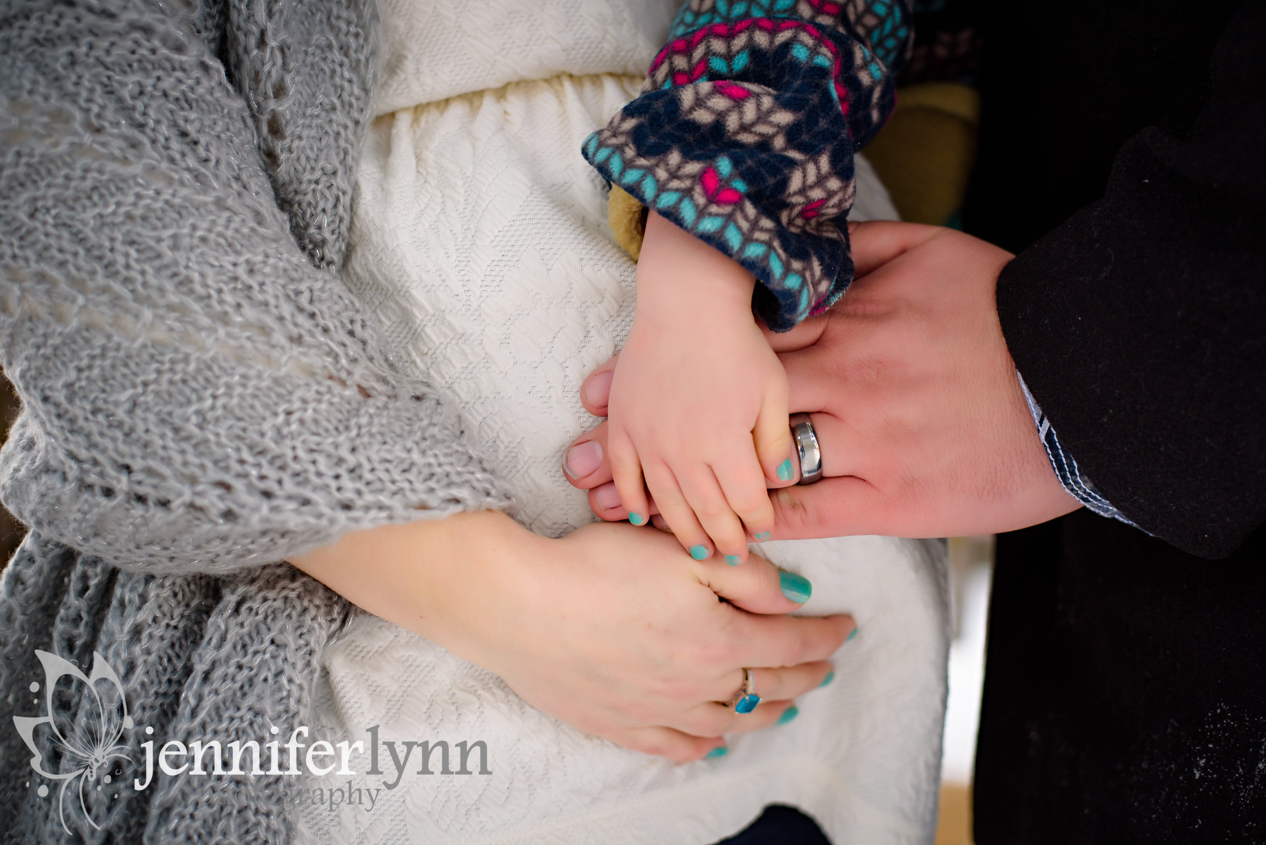 Family Hands on the Baby Bump