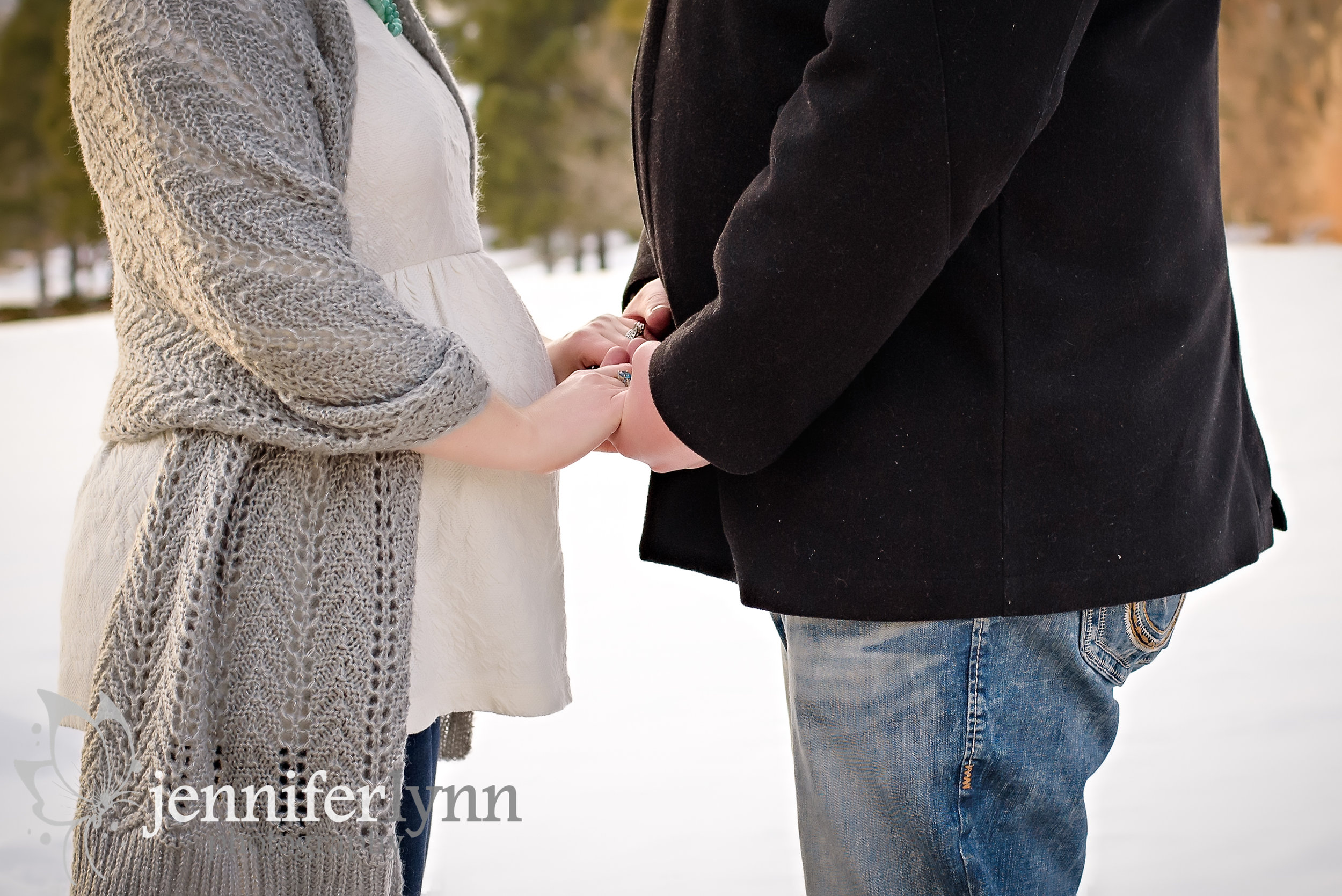 Maternity Husband and Wife Hold Hands Bump