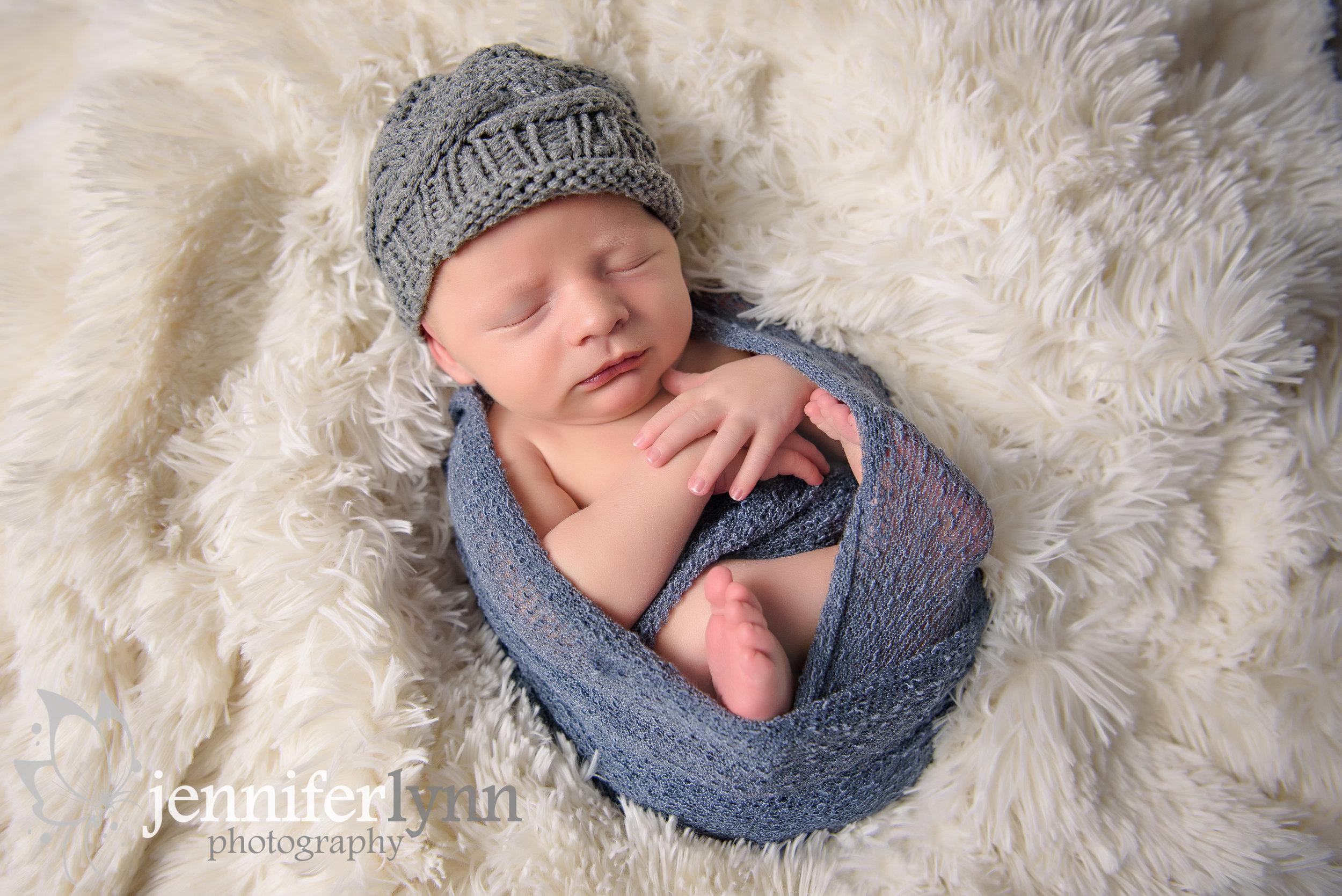 Newborn Boy Fur Wrapped on Back
