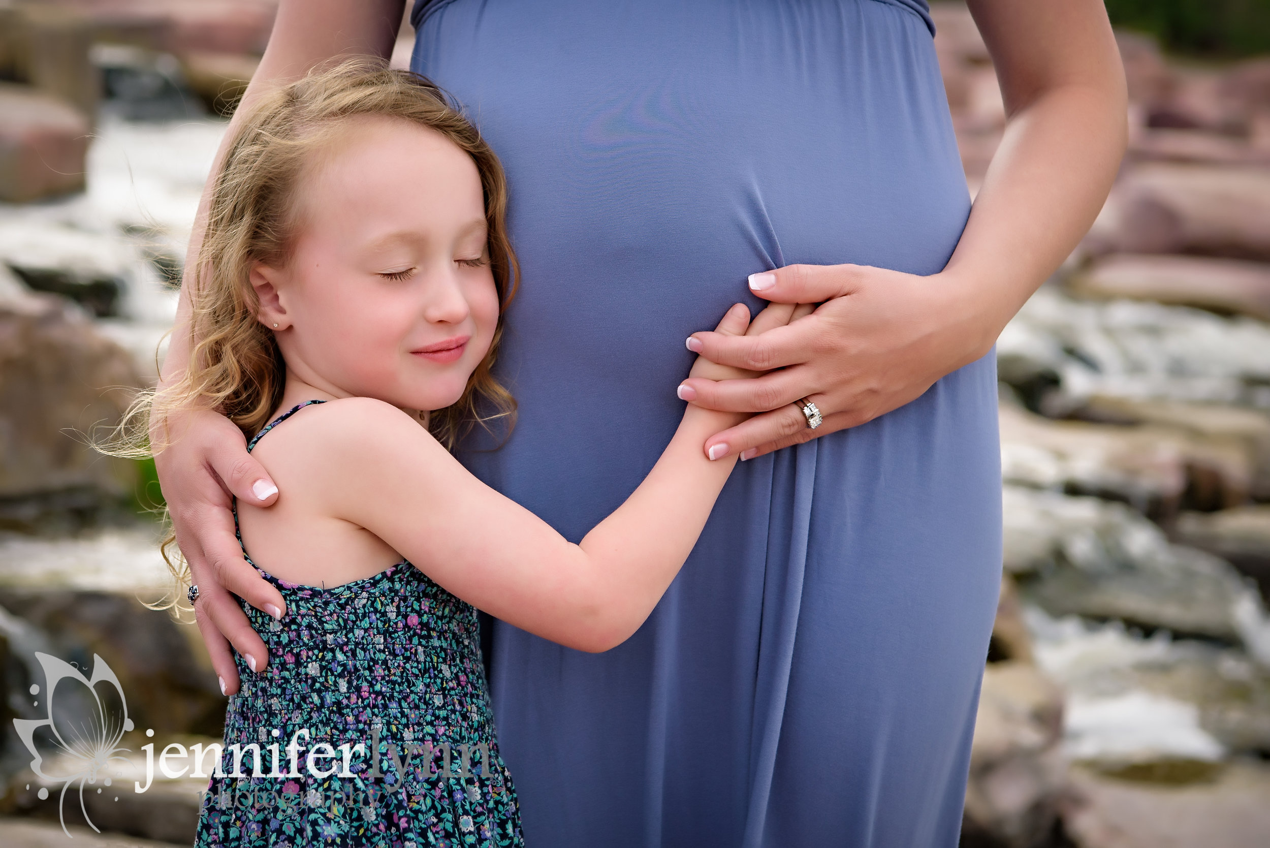Daughter Listening to Mom's Belly