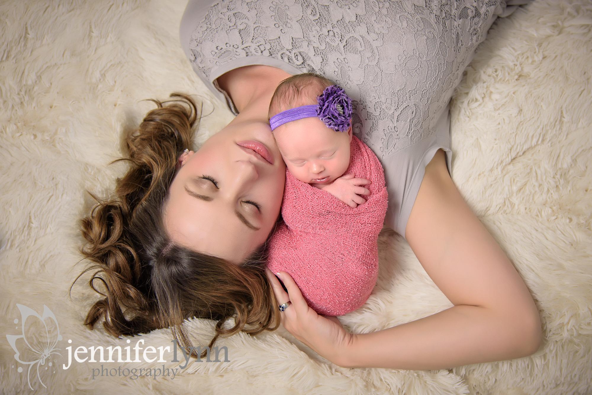 Mom and Newborn Girl Laying Down Fur