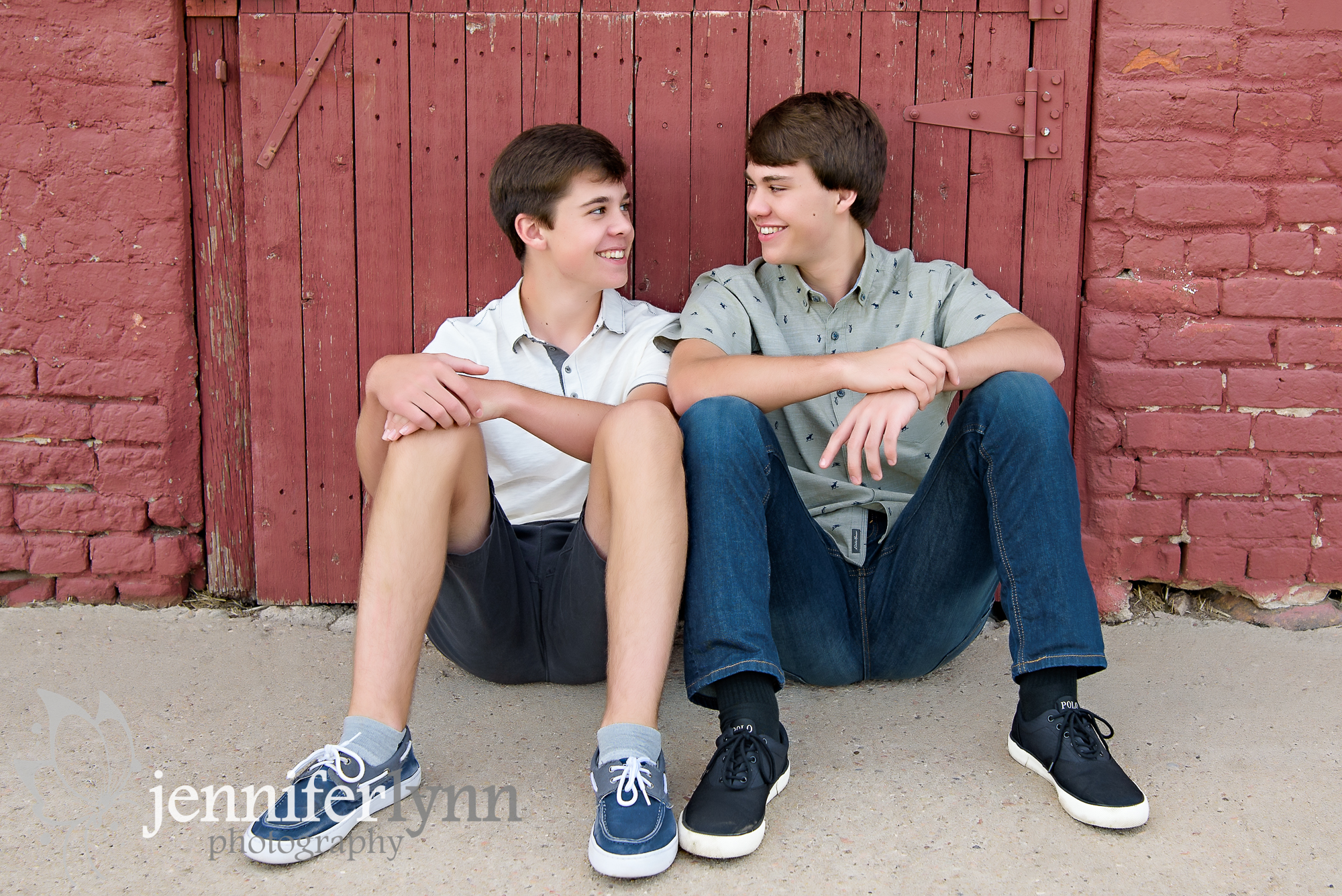 Two Brothers at a Rustic Red Barn