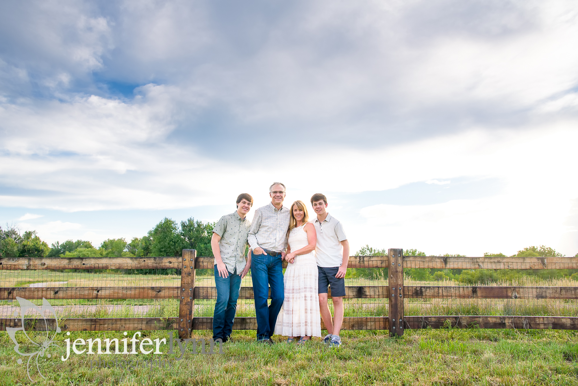 Family Fence Blue Sky Country Setting