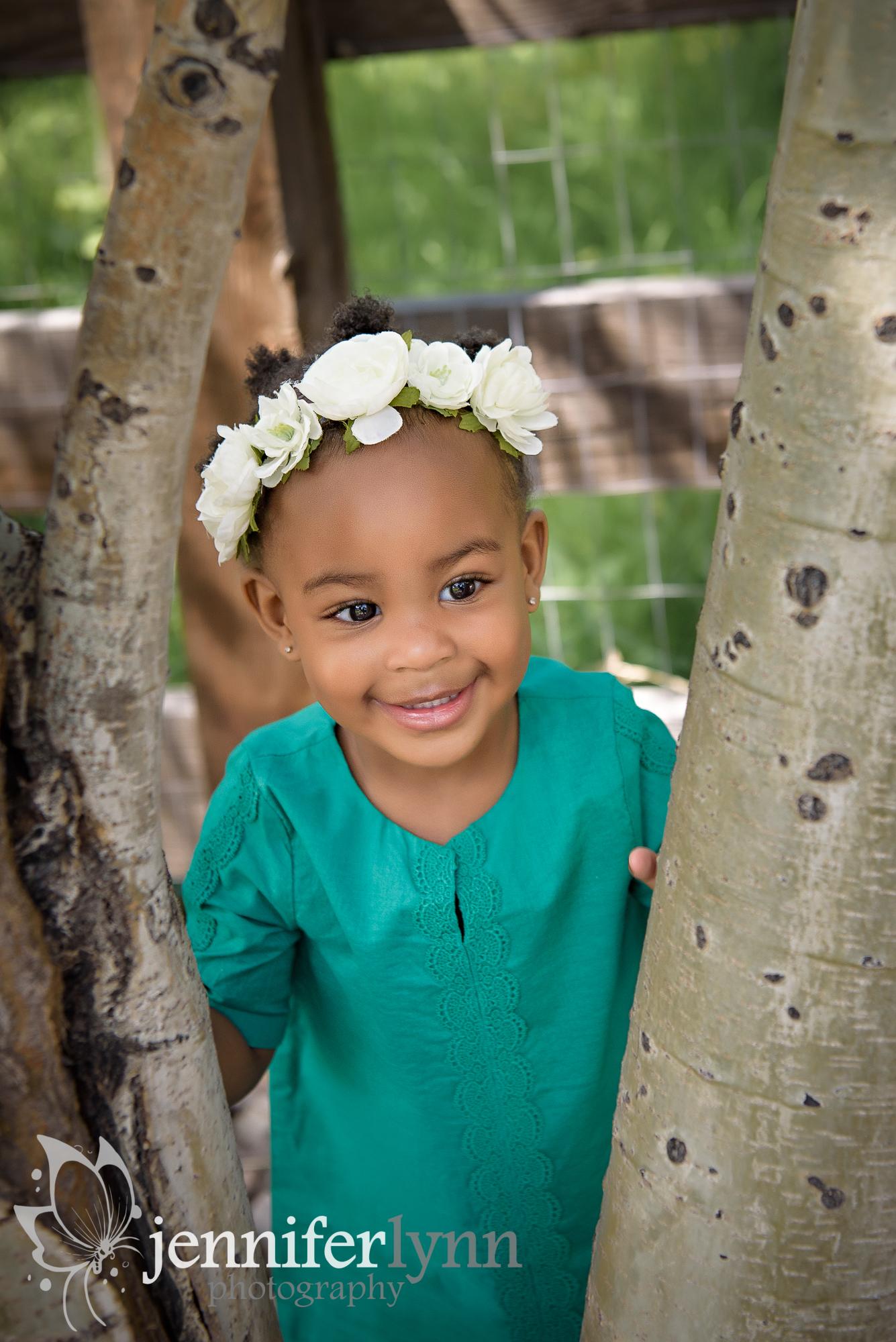 Toddler Peeking Through Aspen Tree