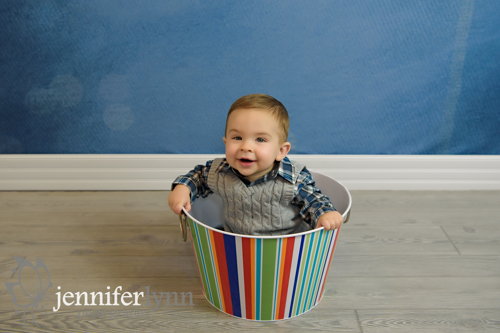 Baby Boy Sitting In Colorful Bucket