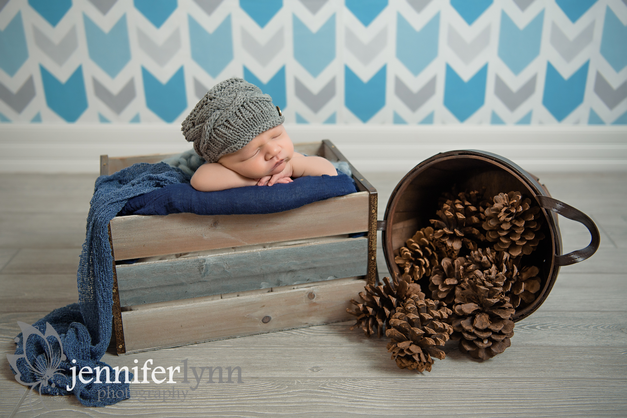 Newborn Boy Chin On Hands Crate Pinecones