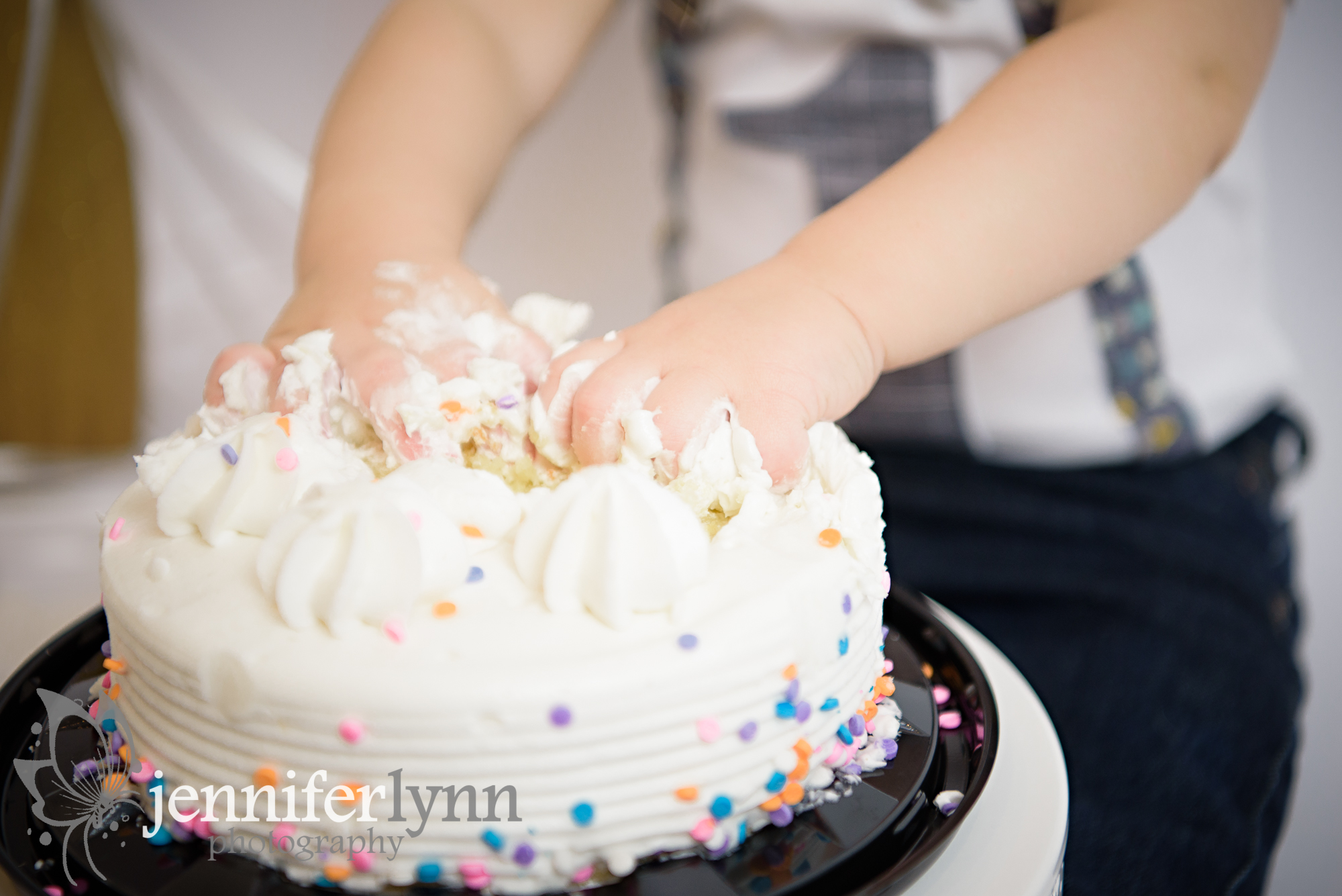 Baby Hands Digging Into Cake