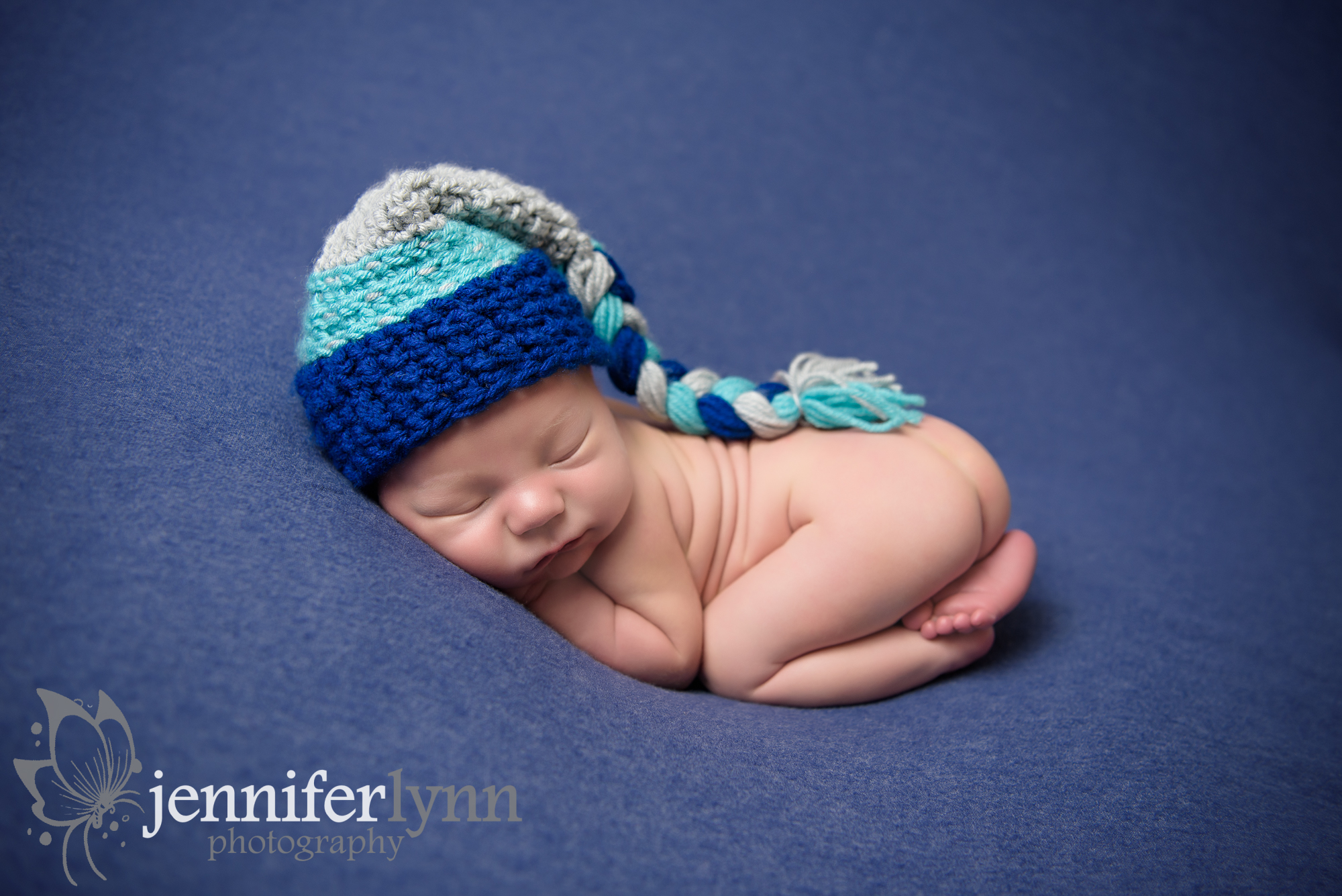 Newborn Boy Tushie Up Blue and Knit Cap