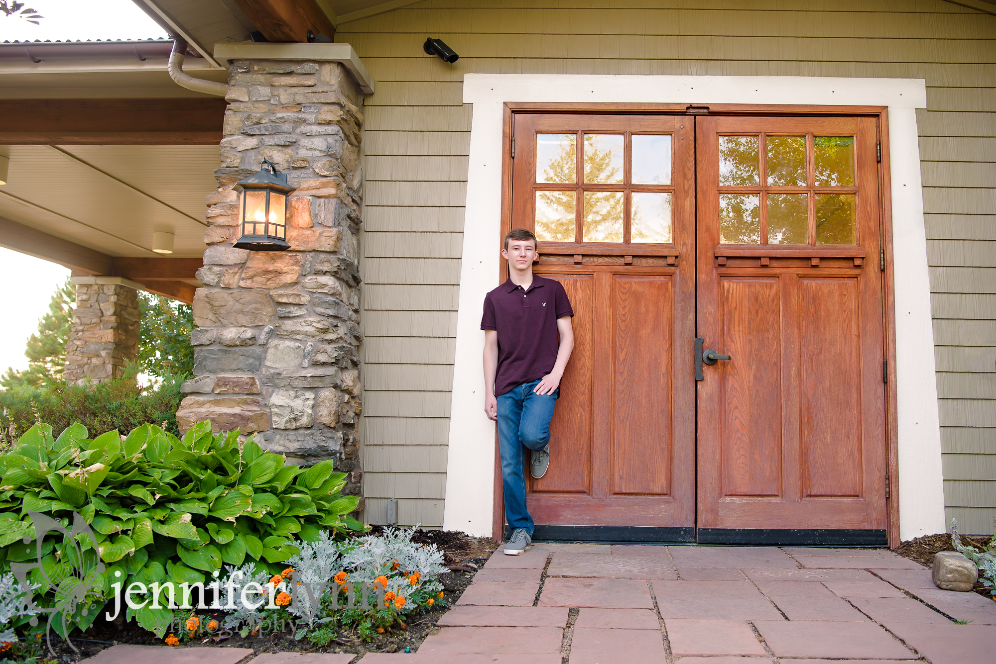 Senior Boy Leaning Back on Big Wooden Door