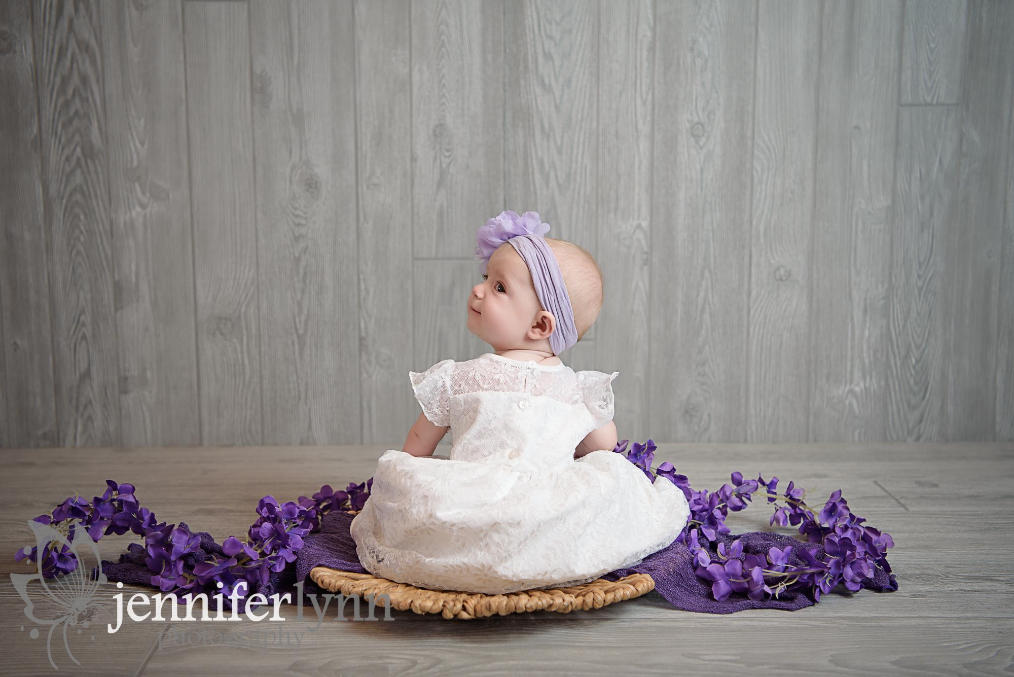 Baby Sitting Purple and White Backwards