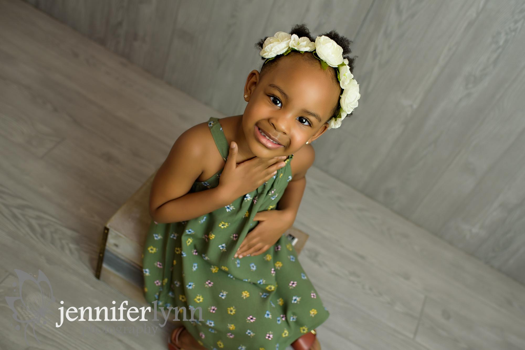 Little Girl Grey Wooden Background Green dress