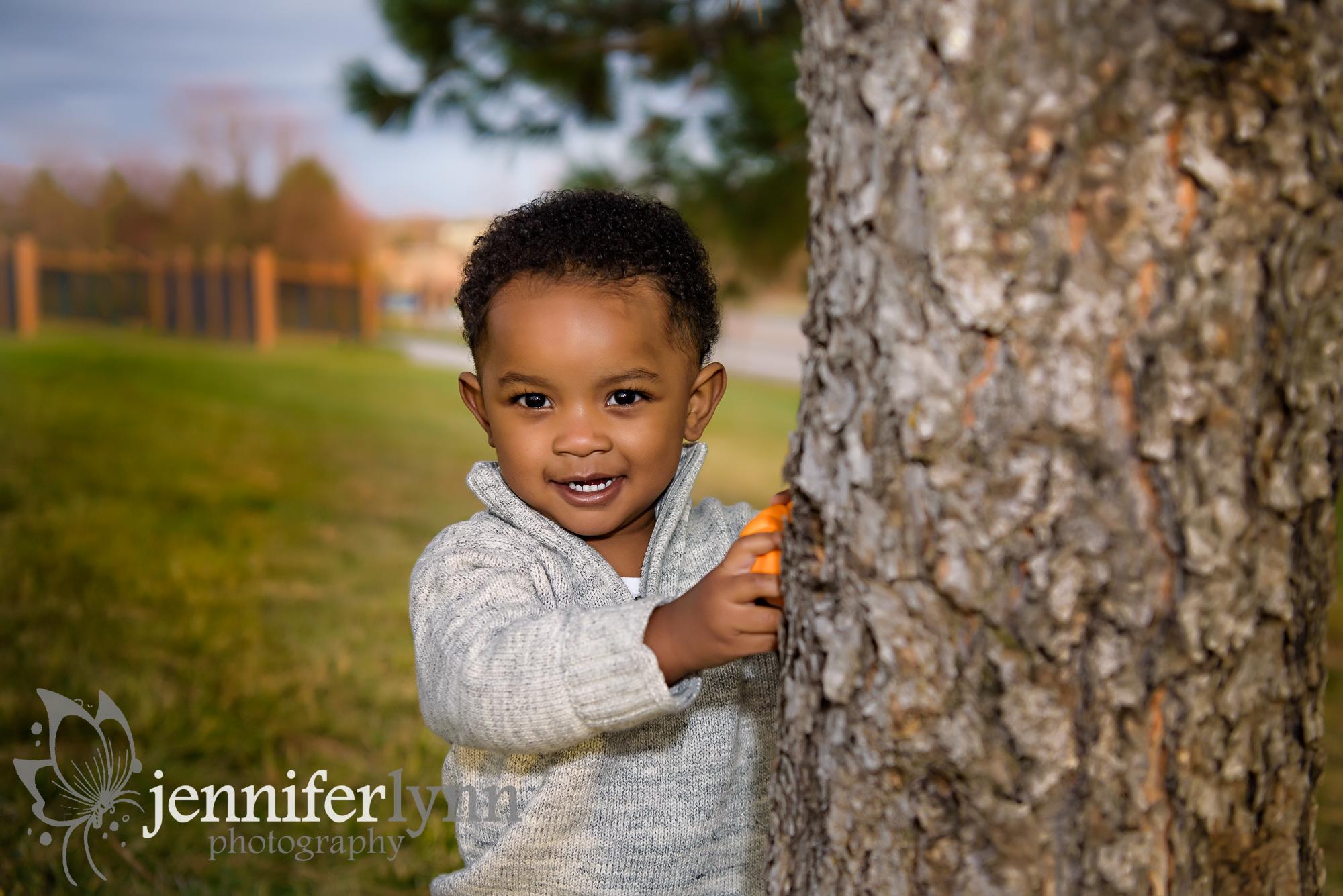 Toddler Peeking from Tree