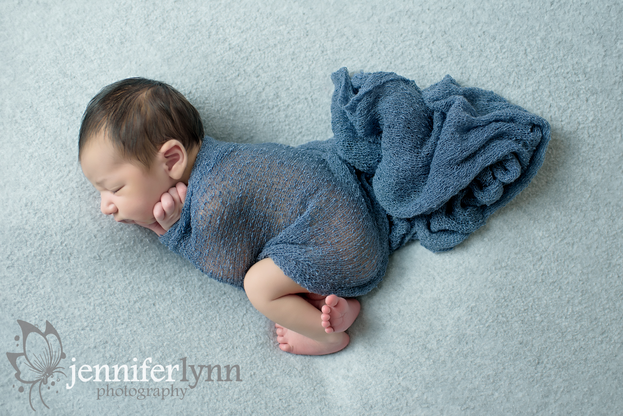 Newborn Boy Grey and Blue Side Laying