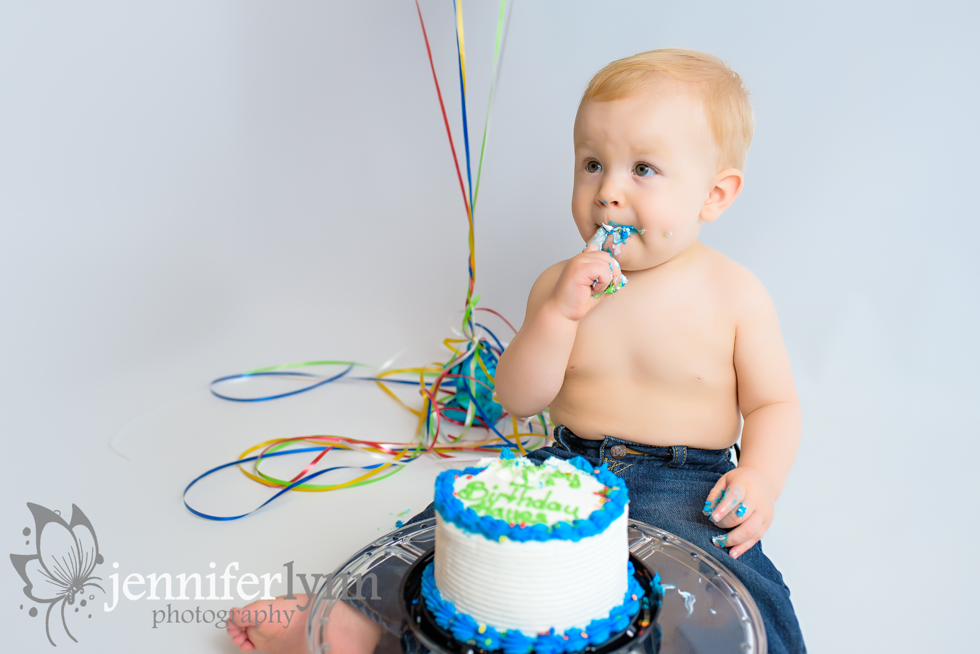 Baby Boy Eating Icing Birthday Session