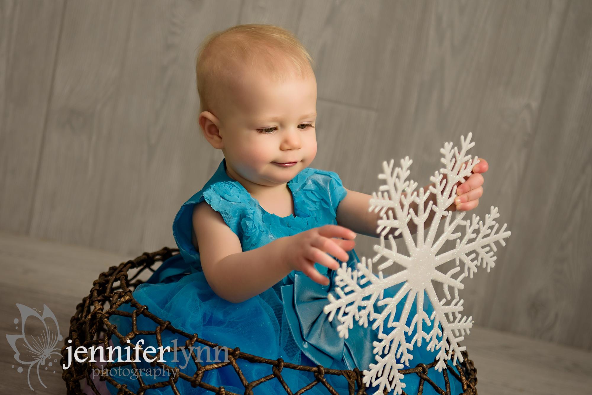 Baby Girl Holding Snowflake