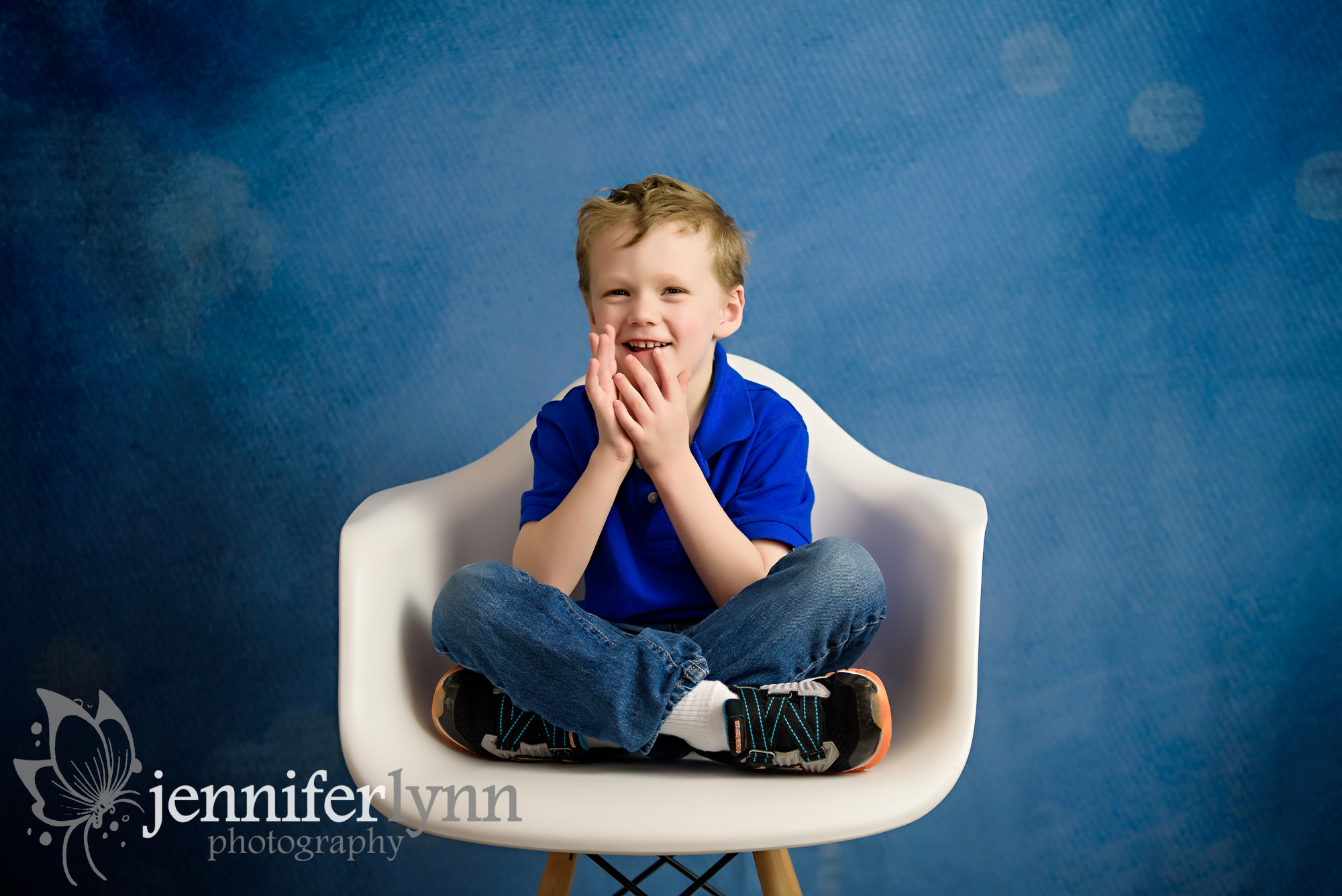 Young Boy White Chair Blue Background