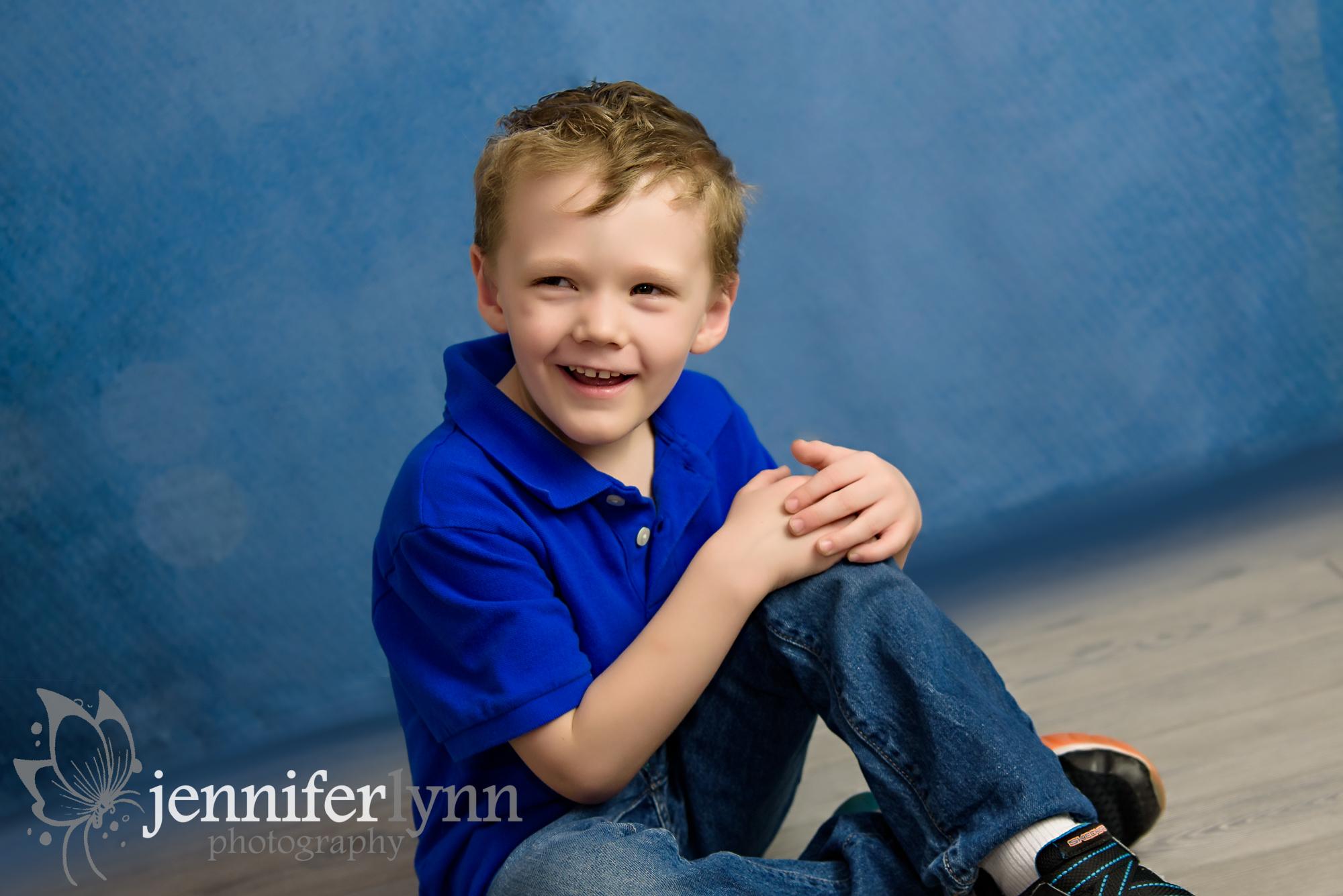 Boy Sitting Grey Wood Blue Shirt