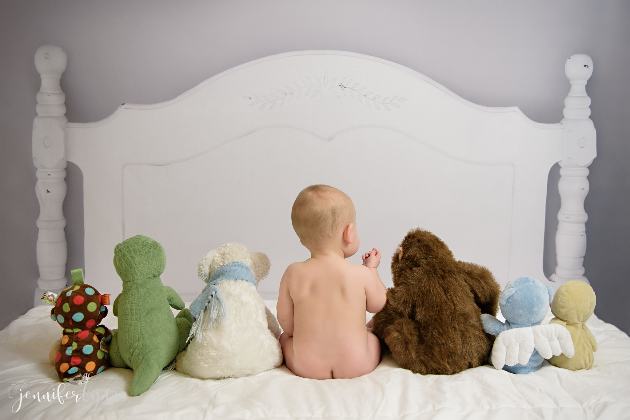Baby and Stuffed Animals in a Row Bed