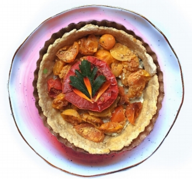 Roasted Tomato Tartlet - SOLD OUT FOR THE SEASONOUR VERY BEST SEASONAL SELLER!Our vine ripened & roasted tomatoes in the classic whole wheat crust, paired with our handmade basil & arugula walnut pesto blended with caramelized onions & chevre. Garnished with our farms sunflower petals. Simple & amazing!