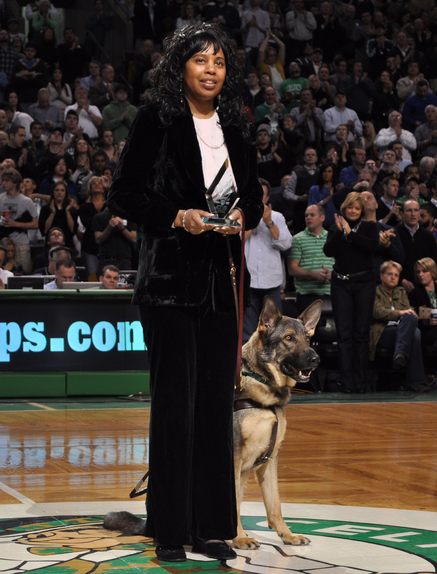 """Janet and her guide dog, Osbourne, receiving the """"Heroes Among Us"""" award from the Boston Celtics and Perkins School for the Blind.  Photo courtesy of Perkins School for the Blind."""