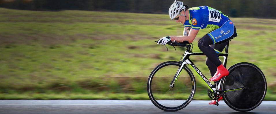 Josh Bennett, a competitive cyclist, racing against the clock in a time trial.