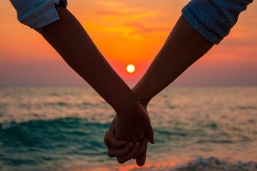 couple-holding-hands-sunset150685331pc.jpg