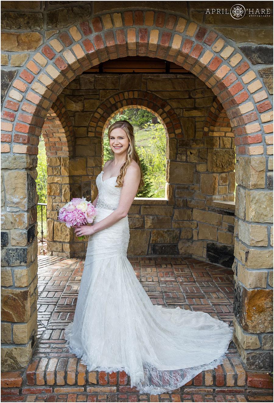 Full-Length-Bridal-Portrait-at-Stone-Gazebo-at-Della-Terra-Mountain-Chateau-in-Estes-Park-Colorado.jpg