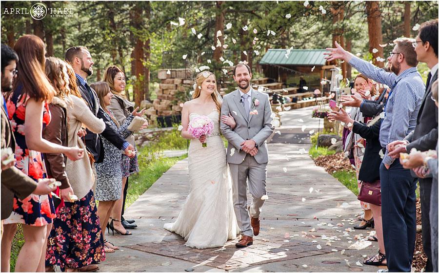 Petal-Toss-Wedding-Ceremony-Exit-at-Della-Terra-Mountain-Chateau-in-Estes-Park-Colorado.jpg