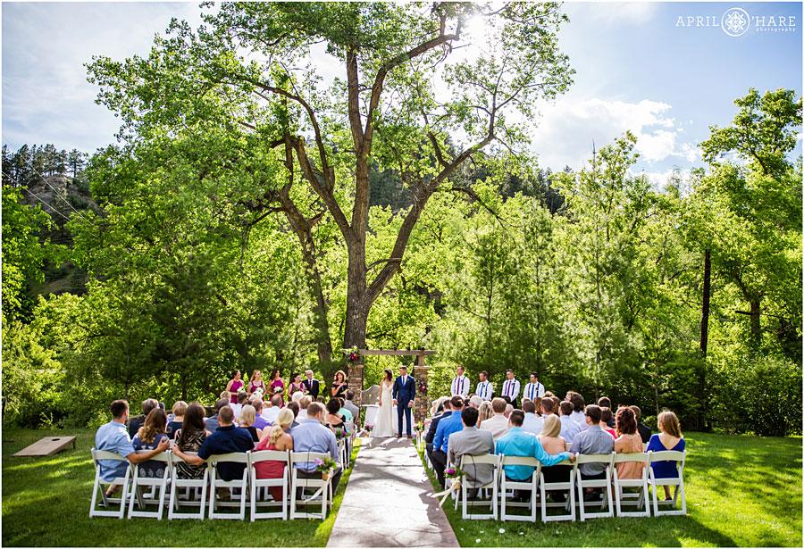 Pretty-CO-sunny-wedding-day-underneath-trees-at-Wedgewood-on-Boulder-Creek.jpg